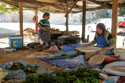 Bread and other delicious traditional food being made at lunch time right below the crag
